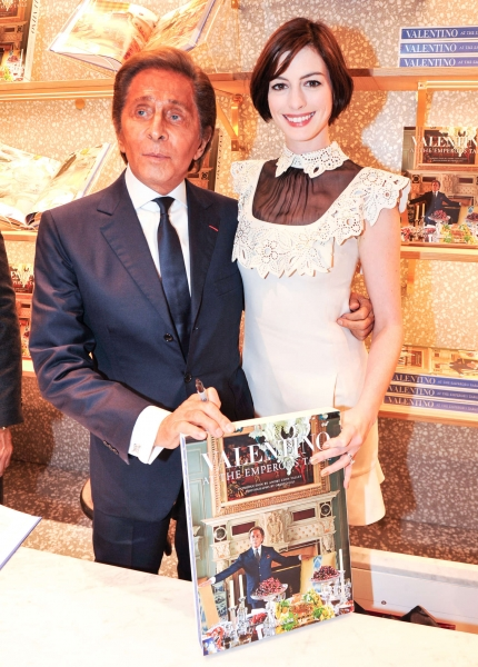 Hathaway and designer Valentino Garavani at VALENTINO At the Emperors Table Book Signing.jpg